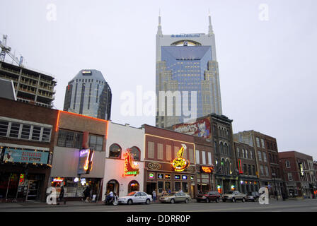 Neon Signs along Streets and Bell South Building in Nashville. Tennessee. USA. - Stock Photo