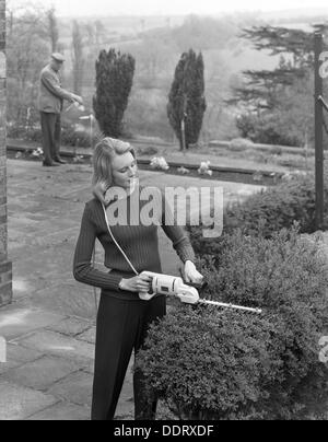 Woman using Stanley electric garden shears, 1965. Artist: Michael Walters - Stock Photo