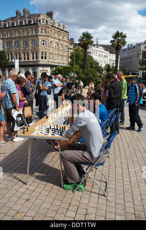 Bournemouth, UK 6 September 2013. Charity Simultaneous Chess Exhibition in Bournemouth Town Square with Meri Grigoryan, - Stock Photo