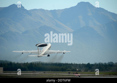 A USAF E-3 Sentry Airborne Warning and Control System out of Joint Base Elmendorf-Richardson takes off in support - Stock Photo