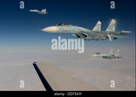 Russian Federation Air Force Su-27 Sukhois intercepts a simulated hijacked aircraft entering Russian airspace Aug. - Stock Photo
