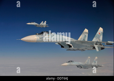 Russian Federation Air Force Su-27 aircraft intercept a simulated hijacked aircraft entering Russian airspace Aug. - Stock Photo