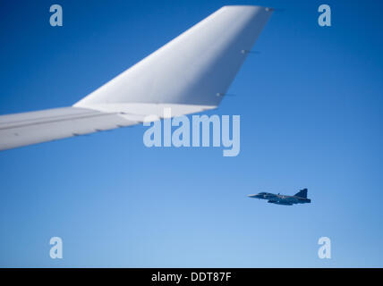A Swedish fighter jet accompanies German ChancellorMerkel's Airbus A340 on the flight back to Berlin from St. Petersburg,Germany, - Stock Photo