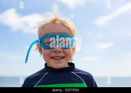 Young Boy wearing Goggles at the Beach - Stock Photo