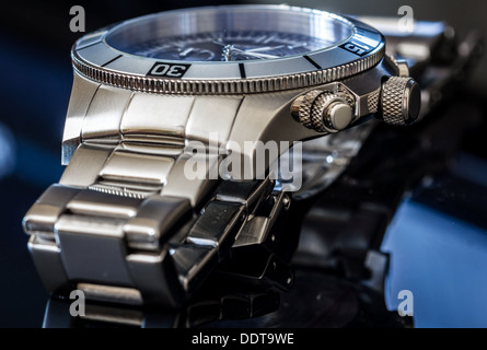 Luxury Watch over reflective surface. Selective focus, shallow depth of field. - Stock Photo