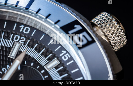 Detail of a luxury watch on black background. Selective focus, shallow depth of field. - Stock Photo