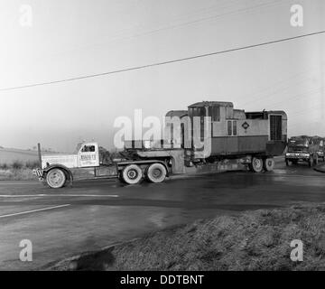 Early 1940s Diamond T truck pulling a large load, South Yorkshire, 1962. Artist: Michael Walters - Stock Photo