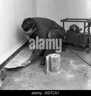 Installing a damp proof course in a house in Goldthorpe, South Yorkshire, 1957.  Artist: Michael Walters - Stock Photo