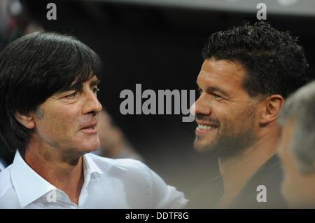 Munich, Germany. 06th Sep, 2013. Germany's head coach Joachim Loew (L) and former German team captain Michael Ballack - Stock Photo