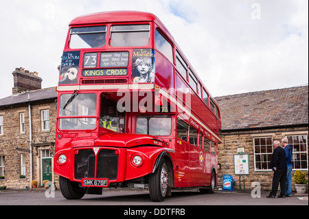 An old red double decker London bus at Leyburn Station on the Wensleydale Railway in Leyburn , North Yorkshire, - Stock Photo