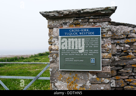 A sign at the entrance to the remains of the 12th century Norse Cross Kirk church at Tuquoy on Westray, Orkney. - Stock Photo