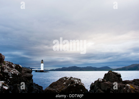 View of Rubhnagall lighthouse at Sound of Mull, near Tobermory, Isle of Mull, Scotland, at sunrise, on overcast - Stock Photo