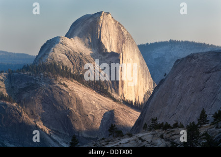 Half Dome seen from Olmsted Point in late afternoon summer light sheen on rockface, Yosemite - Stock Photo