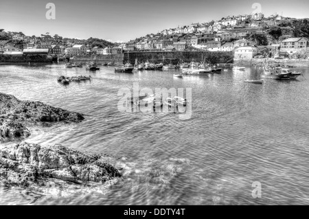 Mevagissey Cornwall England boats on the sea in the harbour in black and white HDR - Stock Photo