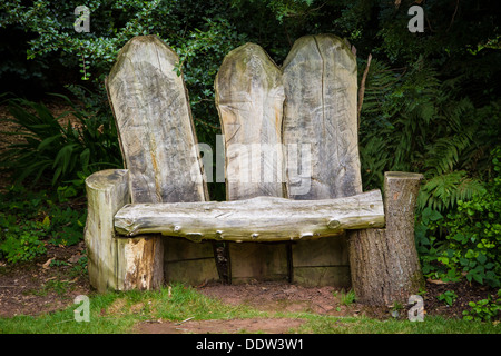 Wooden bench made from tree trunks - Stock Photo