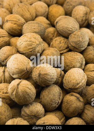 Close-up macro photo of walnuts as brown background - Stock Photo