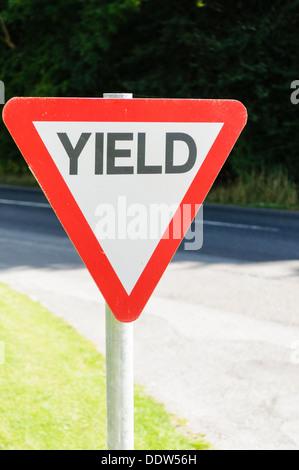 Yield (give-way) sign on an Irish rural road - Stock Photo