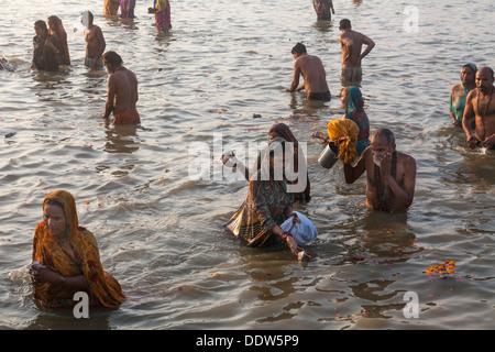 Devotes and Pilgrims taking holy dip in Ganga during the auspicious day at Kumbh Mela 2013, Allahabad, UP India - Stock Photo