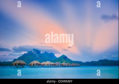 Sunrise and bungalows. Bora Bora. French Polynesia. - Stock Photo