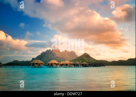 Bungalows over water and Mt. Otemanu. Bora Bora. French Polynesia - Stock Photo