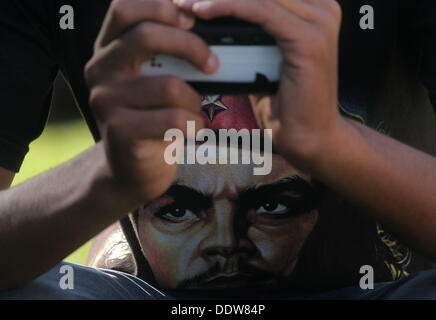Srinagar, Kashmir, India. 7th Sep, 2013. A youth takes photos with a cell phone during the Haqeeqat-e-Kashmir concert. - Stock Photo