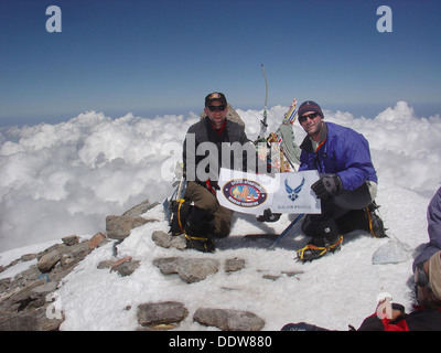 US Air Force Capt. Rob Marshall and 1st Lt. Mark Uberuaga pose on the summit of Mount Elbrus July 31, 2005 in Russia. - Stock Photo