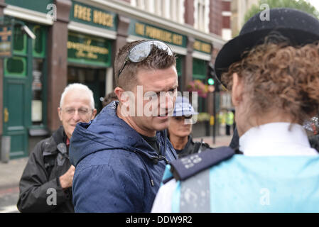 London, UK. 07th Sep, 2013. EDL leader, Tommy Robinson, talking to police officers at the beginning of a march held - Stock Photo