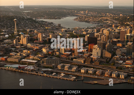 Aerial view of Seattle Skyline along waterfront with Space Needle at sunset - Stock Photo