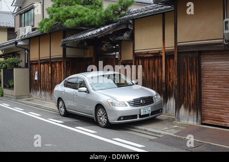 A Nissan car parked in a street in Kyoto, Japan. - Stock Photo