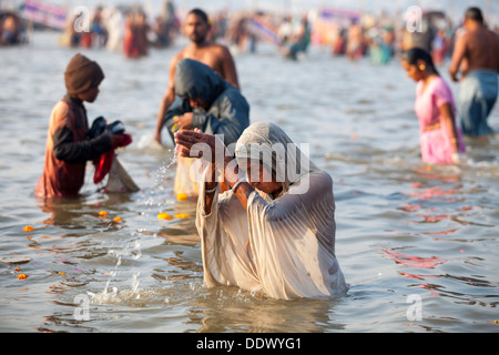 Devotes and Pilgrims taking holy dip in Ganga during the auspicious day at Kumbh Mela 2013, Allahabad, UP India - Stock Photo