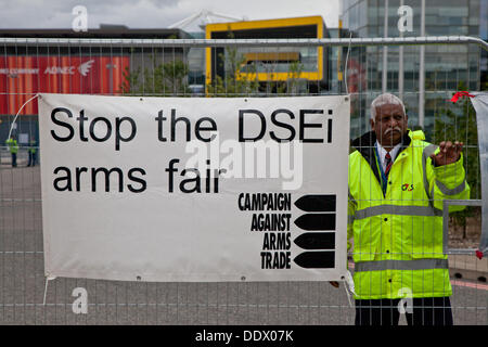 London, UK. Sunday, September the 8th Anti arms protestors block entrances to the Excel centre where the DSEI arms - Stock Photo