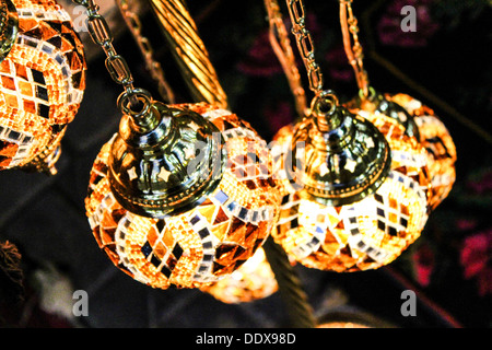 Traditional Turkish glass lights hanging from a shop in Istanbul - Stock Photo