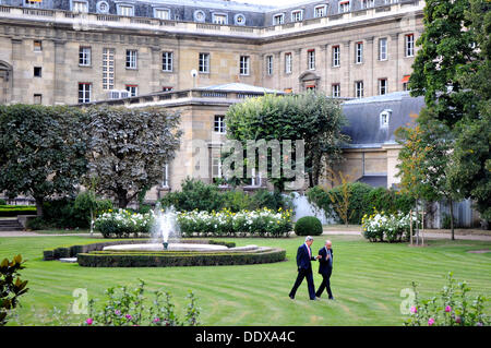 US Secretary of State John Kerry walks with French Foreign Minister Laurent Fabius on the grounds at the French - Stock Photo
