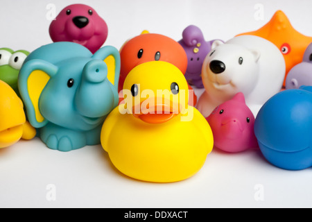 Rubber duck and friends against white background - Stock Photo