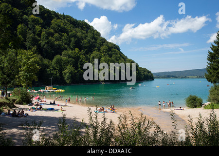 Beach on Lake (Lac) Chalain in the Jura region of France - Stock Photo