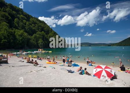 Beach on Lake Chalain (Lac Chalain) in the Jura region of France - Stock Photo