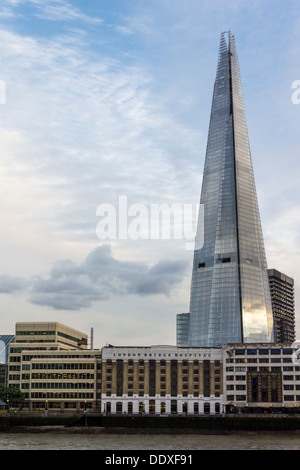 The Shard (aka the Shard London Bridge, and formerly London Bridge Tower) and London Bridge Hospital from across - Stock Photo