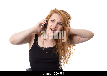 Model Released. Young Woman Using Mobile Telephone - Stock Photo