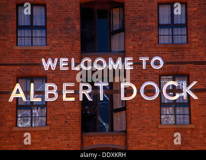 Welcome to Albert Dock sign inLiverpool at dusk / night , Merseyside , England , UK blue hour - Stock Photo