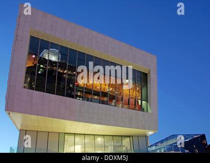Albert Dock reflected in new museum at Nighttime liverpool Merseyside England UK - Stock Photo