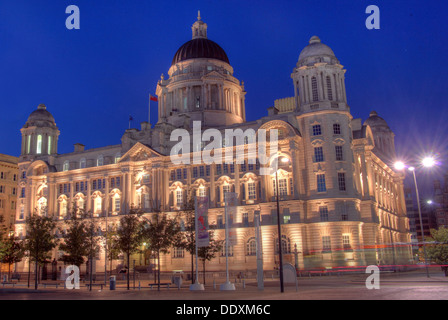 Pier Head Port of Liverpool at Nighttime Merseyside England UK - Stock Photo
