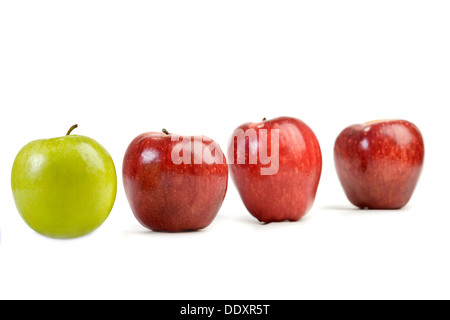 Ripe red apples and one green apple isolated on white - Stock Photo