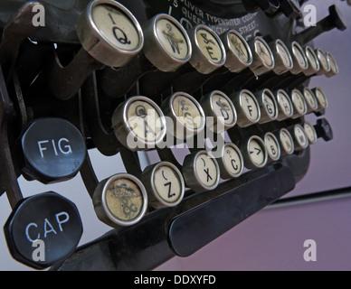Old classic victorian typewriter machine. Black with ivory keys - Stock Photo