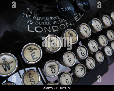 Old classic victorian typewriter machine. Black with ivory keys - Stock Photo