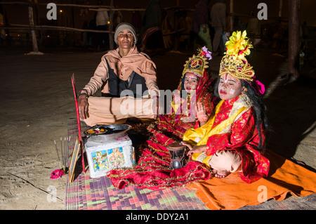 Children dressed as goddesses, during Kumbha Mela - Stock Photo