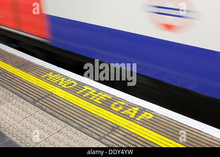Mind the gap warning at station on the London Underground, England - Stock Photo