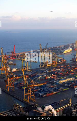General view of the industrial harbour from the top of the mountain of Montjuic, Barcelona, Catalonia, Spain - Stock Photo