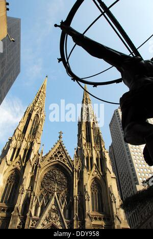 Partial view of the Rockefeller Center's Atlas Statue across Fifth Avenue from Saint Patrick's Cathedral. Midtown - Stock Photo