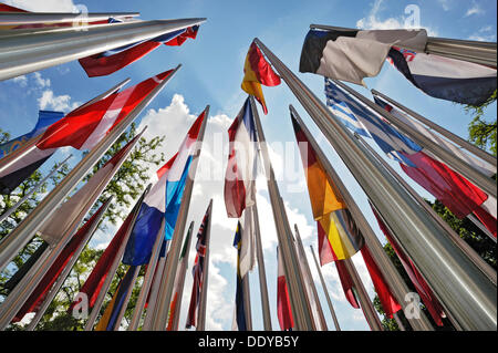 Various international flags on poles in the wind, Munich, Bavaria - Stock Photo