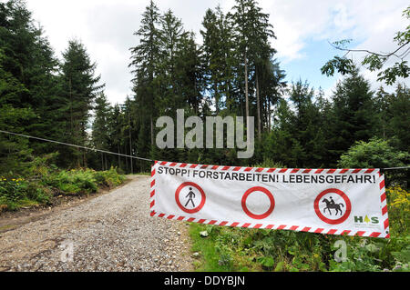 Barrier, warning of forestry work in the forest near Wenger-Egg-Alpe, alp, Allgaeu region, Bavaria - Stock Photo